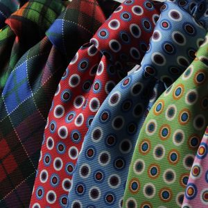 an assortment of colored ties