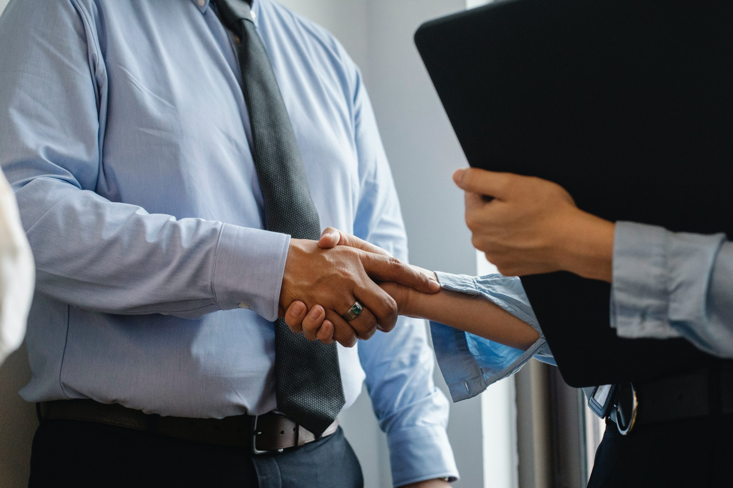 Operations consultants shaking hands.